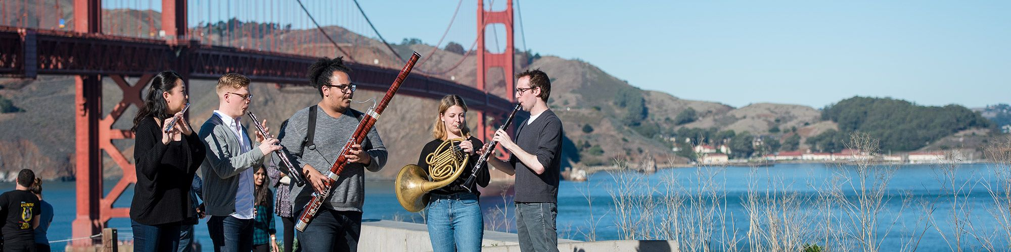 SFCM students out in San Francisco: woodwind quintet plays near Golden Gate Bridge