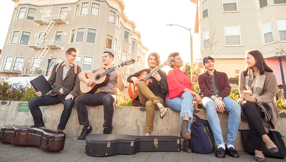Students guitarists posing for evening photo in Patricia Green park Octavia St