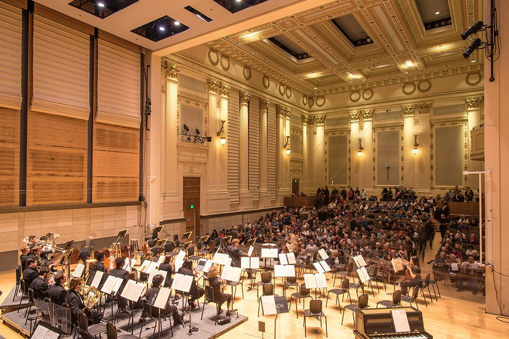 Orchestra in concert hall during performance