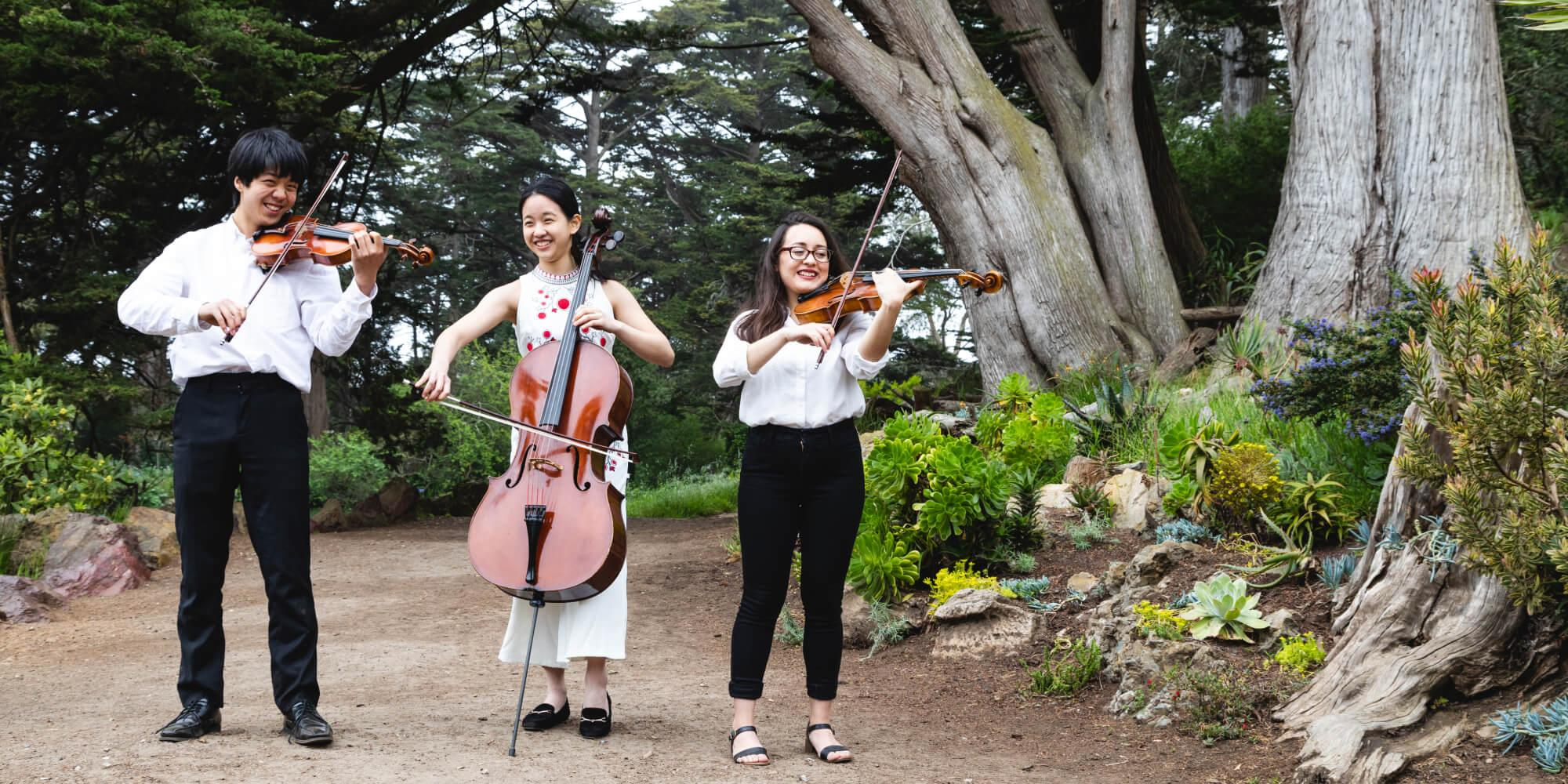 Conservatory students playing music in the park