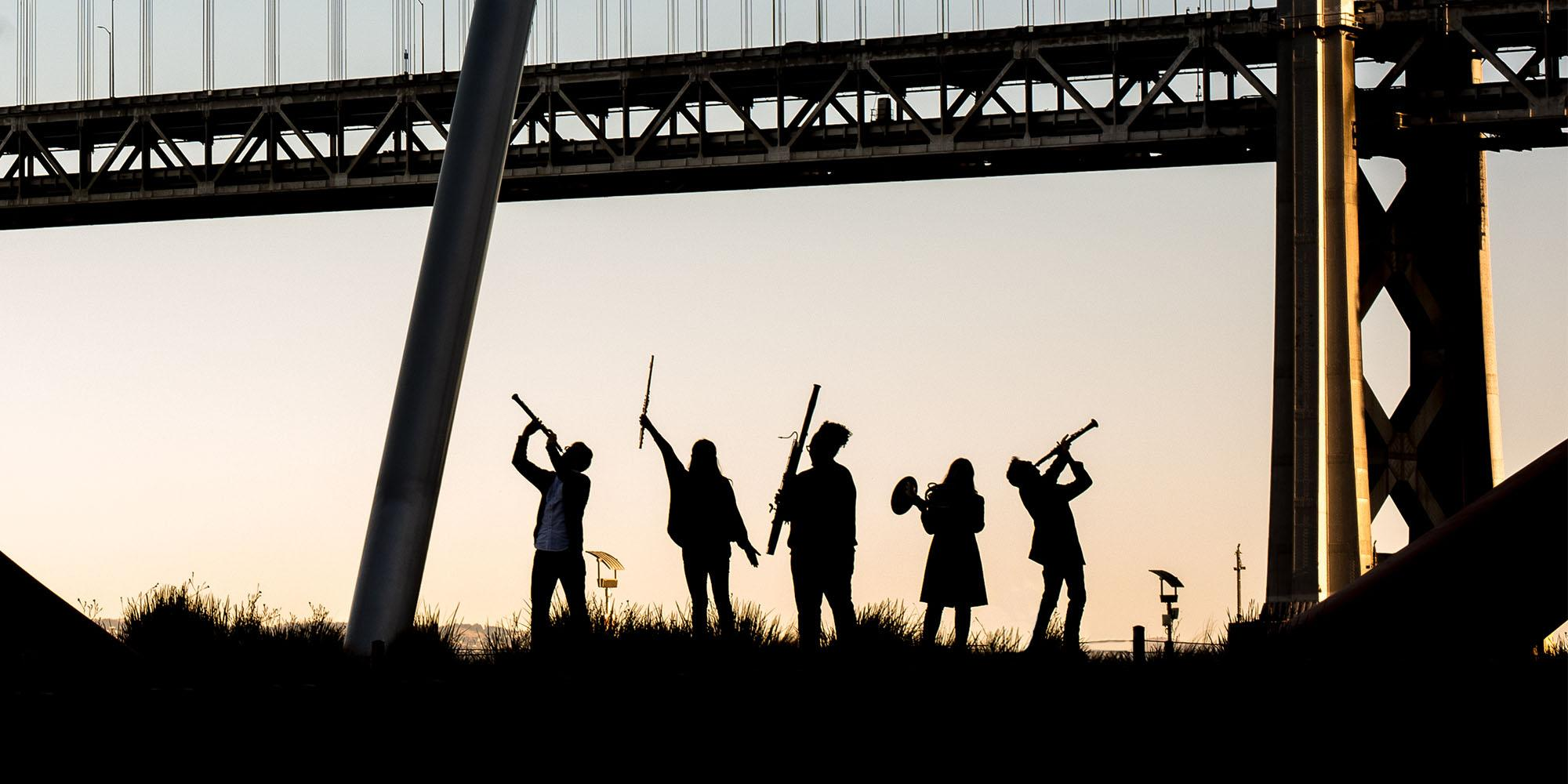 A photo of students by the Bay Bridge