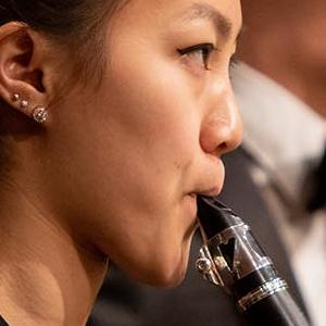 A SFCM student clarinetist performing with an orchestra