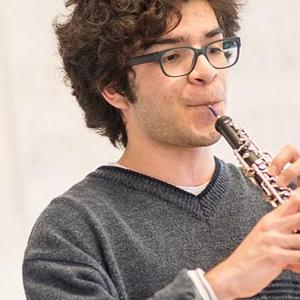 A photo of a student playing oboe