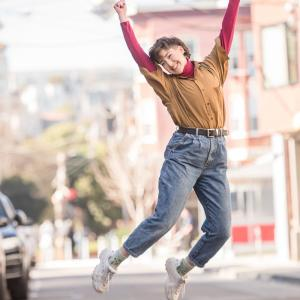 Student jumping up in excitement while outside