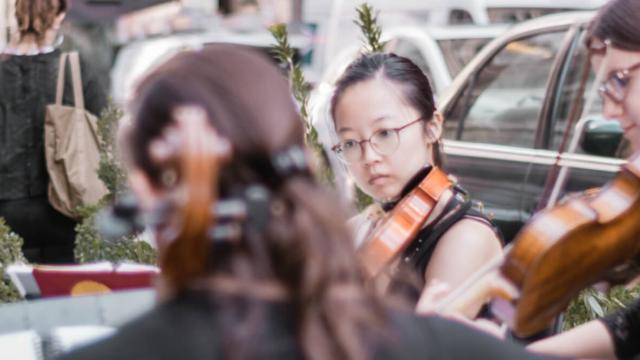 Conservatory students performing on the street