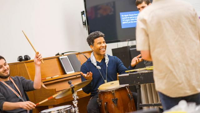 A photo of an SFCM faculty member playing the drums