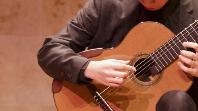 A San Francisco Conservatory of Music student playing the guitar