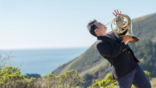 SFCM Student playing french Horn outside