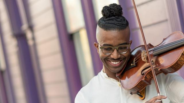 SFCM student playing violin outside