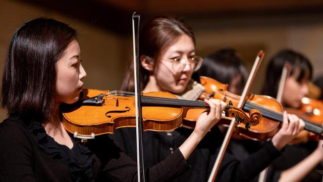 A SFCM student violinist performing with the SFCM orchestra