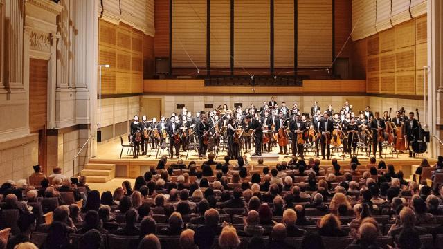 Caroline H. Hume Concert Hall performance orchestra full house wide panoramic