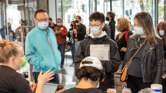 Oliver Wang '24 and his parents at the check-in counter.