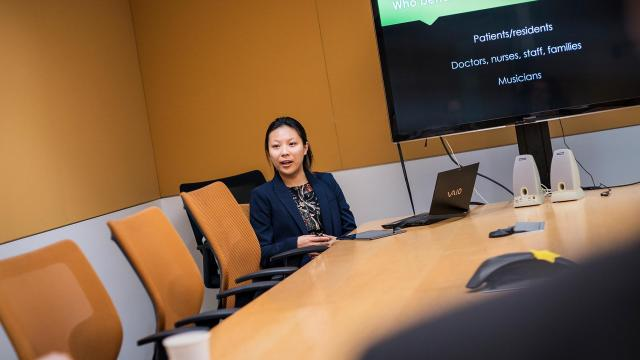 A photo of a student making a presentation at the San Francisco Conservatory of Music