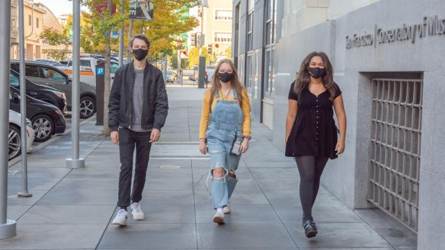 SFCM students wearing masks outside 50 Oak building