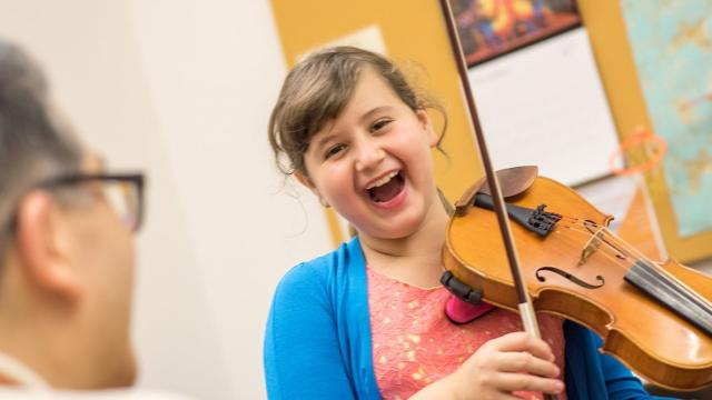 SFCM Early Childhood student playing violin