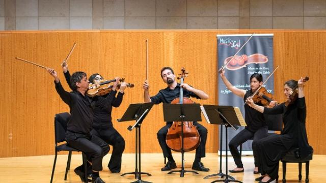 A quartet of students and faculty performing