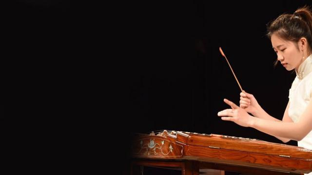 A student from the Shanghai Conservatory performing on a folk instrument